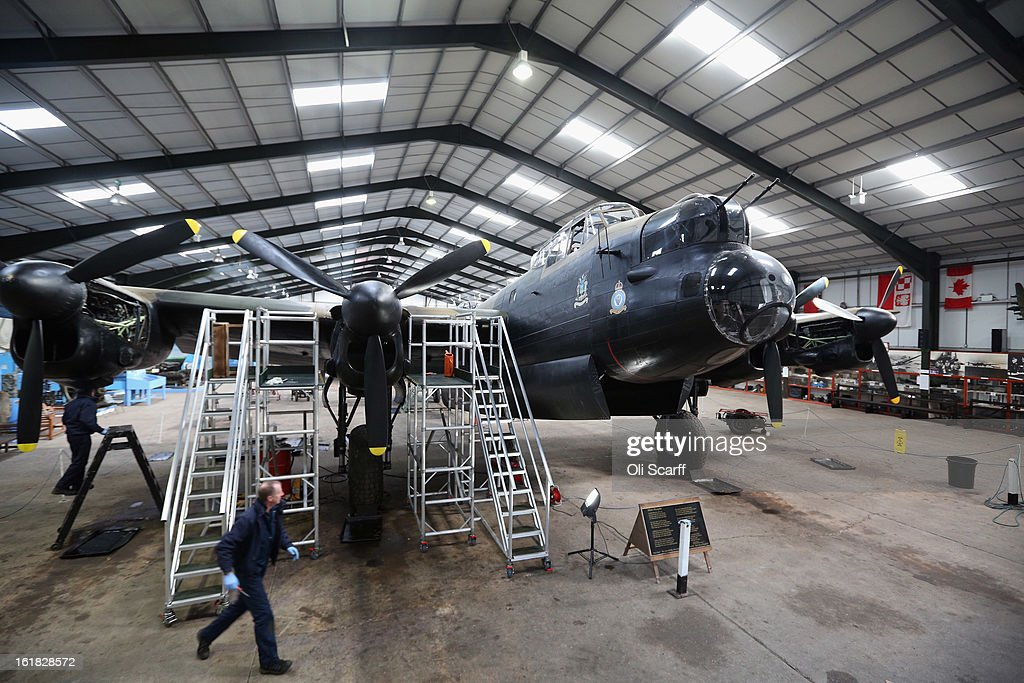 Engineers Keith Breachley and Bob Mitchell (L) work on the Lancaster bomber 'Just Jane' , with the aim of getting it airworthy, at Lincolnshire Aviation Heritage Centre on February 14, 2013 in East Kirkby, England. The plane, which last flew in 1971, would become one of only three airworthy Lancaster bombers in the world. Brothers Fred and Harold Panton, owners of the Lincolnshire Aviation Heritage Centre, are restoring the plane in memory of their sibling, Christopher Panton, who died aged 19 when his Lancaster was shot down in 1944.