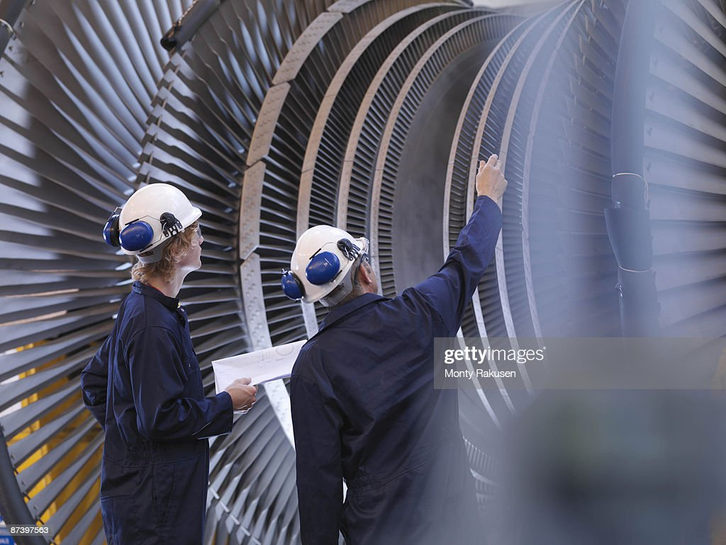 Engineers Looking At Turbine : Stock Photo