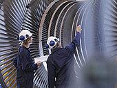 Engineers Looking At Turbine