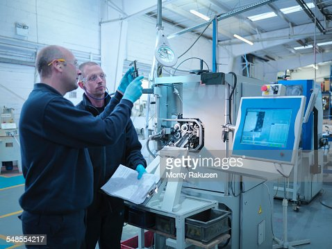 Engineers manufacturing automotive parts