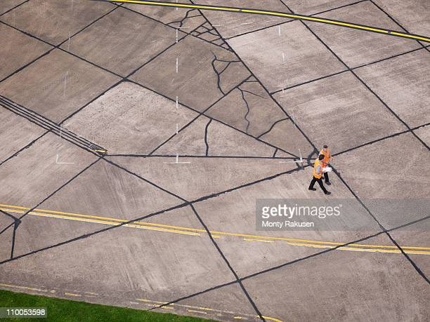 Engineers on aircraft runway