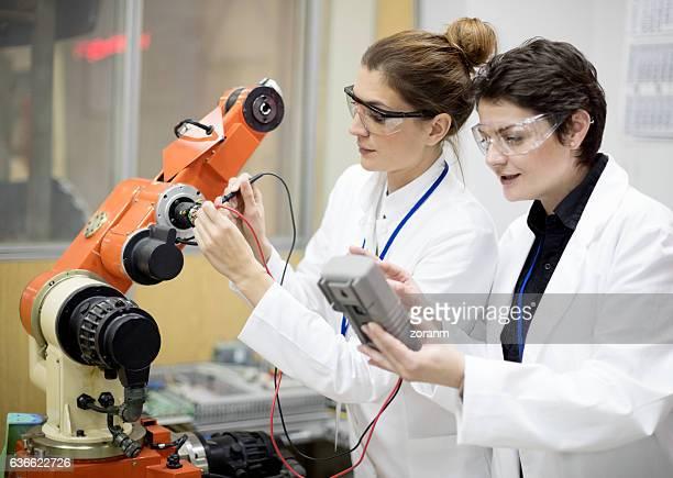 Engineers reparing machine