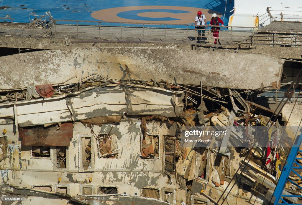 Engineers start to inspect the Costa Concordia after the righting operation on September 18 2013 in Isola del Giglio Italy The vessel which sank on...