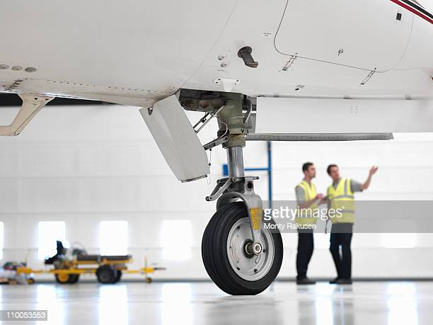 Engineers with jet aircraft wheel