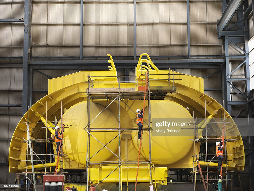 Engineers with mid water arch flotation device in shipping yard