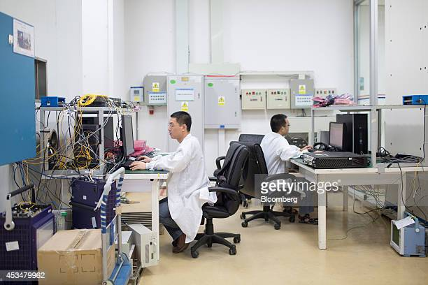 Engineers work at computers inside the global compliance and testing center at the Huawei Technologies Co campus in the Longgang district of Shenzhen...