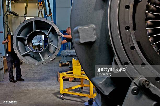 Engineers work on the assembly of turbocharging units at the ABB Turbo Systems plant operated by ABB AG in Baden Switzerland on Tuesday Aug 30 2011...
