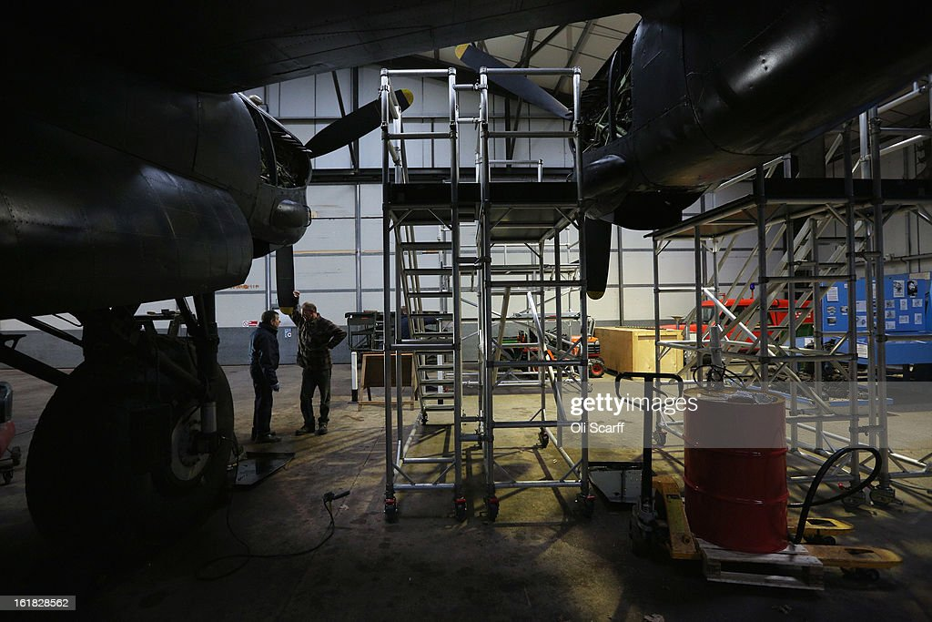 Engineers work on the Lancaster bomber 'Just Jane' , with the aim of getting it airworthy, at Lincolnshire Aviation Heritage Centre on February 14, 2013 in East Kirkby, England. The plane, which last flew in 1971, would become one of only three airworthy Lancaster bombers in the world. Brothers Fred and Harold Panton, owners of the Lincolnshire Aviation Heritage Centre, are restoring the plane in memory of their sibling, Christopher Panton, who died aged 19 when his Lancaster was shot down in 1944.