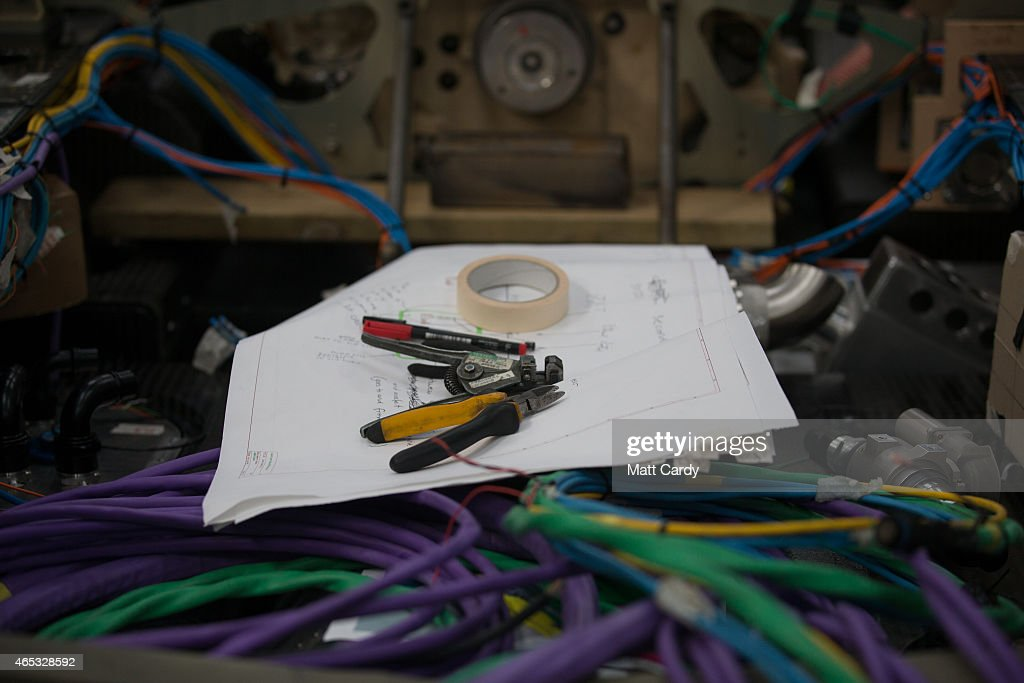 Engineers work on the wiring loom in the rear end of the Bloodhound SSC vehicle currently taking shape at its design centre in Avonmouth on March 5...