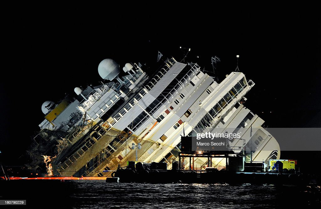 Engineers work on the wreckage of the Costa Concordia during the night as the parbuckling operation to raise the ship continues on September 16, 2013 in Isola del Giglio, Italy. Work began today to right the stricken Costa Concordia vessel, which sank on January 12, 2012. If the operation is successful, it will then be towed away and scrapped. The procedure, known as parbuckling, has never been carried out on a vessel as large as Costa Concordia before.