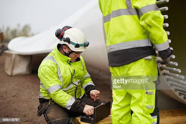 Engineers working on wind turbine