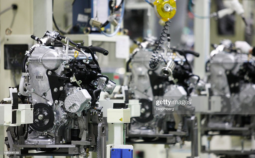 Engines for the Toyota Motor Corp. Aqua hybrid compact car are manufactured on the production line of Toyota Motor East Japan Inc.'s Miyagi Taiwa Plant in Taiwa, Miyagi Prefecture, Japan, on Friday, Dec. 14, 2012. Toyota Motor East Japan Inc. commenced operations at the plant today. Photographer: Tomohiro Ohsumi/Bloomberg via Getty Images