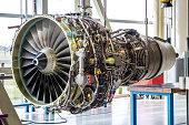 Engine's maintenance in huge industrial hall .