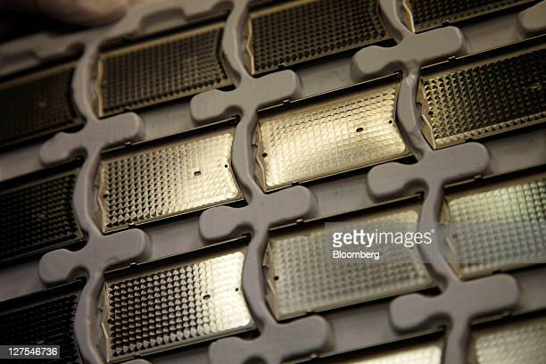 Engineturned back covers of Vertu mobile handsets are seen during manufacture at Nokia Oyj's Vertu luxury phone division in Church Crookham UK on...