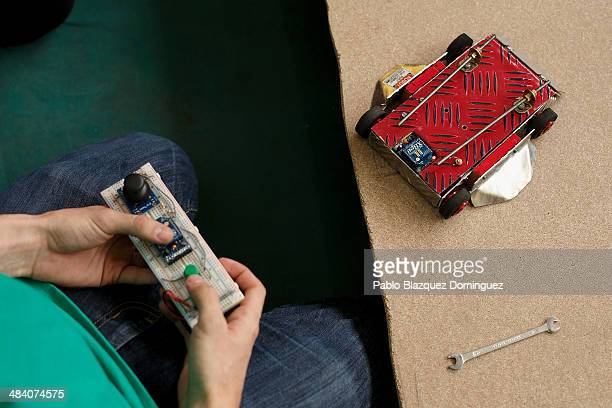 Enginnering student Carlos Hucha tests his robot 'Troncomovil' before a sumo robots combat during the Cybertech robotics competition at the the...