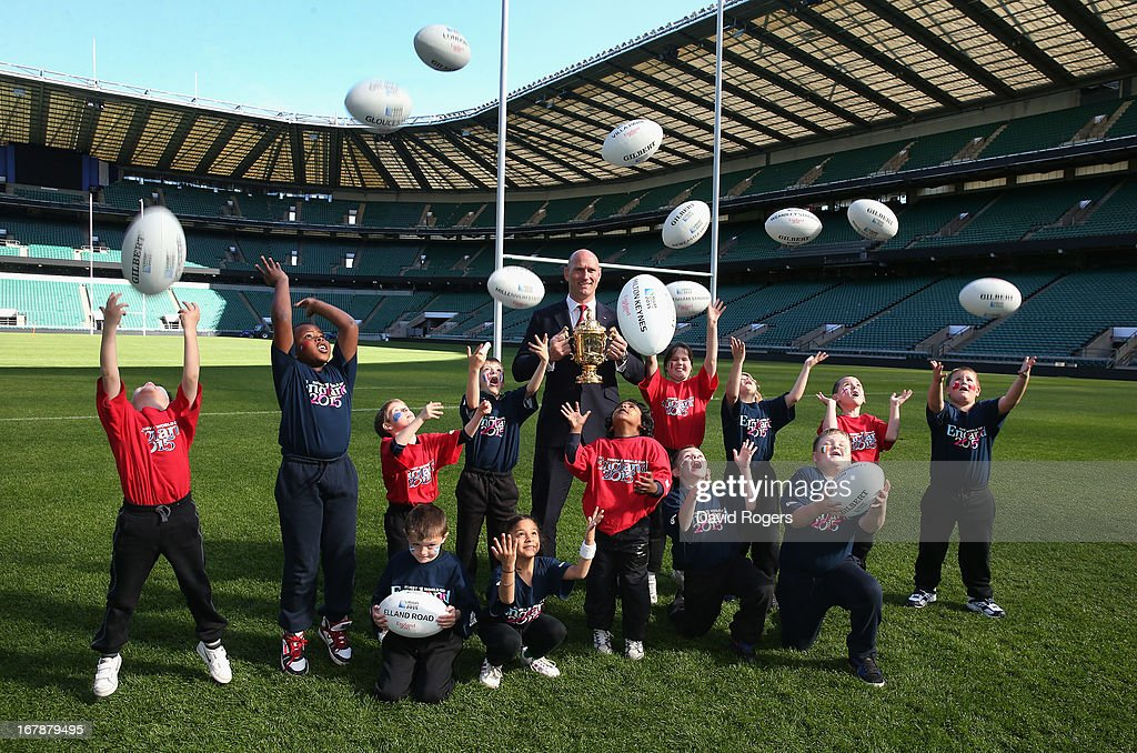 England 2015 ambassador <a gi-track='captionPersonalityLinkClicked' href=/galleries/search?phrase=Lawrence+Dallaglio&family=editorial&specificpeople=162771 ng-click='$event.stopPropagation()'>Lawrence Dallaglio</a>, poses with school children during the IRB Rugby World Cup 2015 Schedule Annoucement held at Twickenham Stadium on May 2, 2013 in London, England. The 13 Match Venues and Host Cities selected are: Twickenham Stadium (London), Wembley Stadium (London), Olympic Stadium (London), Millennium Stadium (Cardiff), Manchester City Stadium (Manchester), St James' Park (Newcastle), Elland Road (Leeds), Leicester City Stadium (Leicester), Villa Park (Birmingham), Kingsholm Stadium (Gloucester), stadiummk (Milton Keynes), Brighton Community Stadium (Brighton) and Sandy Park (Exeter).