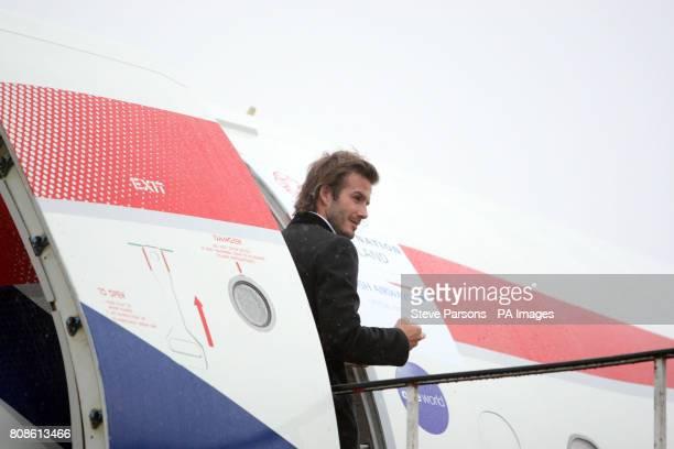 England 2018 Vice President David Beckham boards a British Airways flight to Zurich at Heathrow Airport London