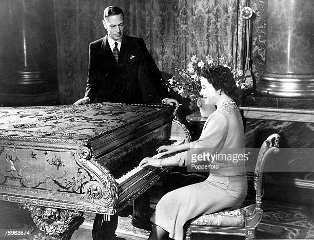 England 20th April Queen Elizabeth plays tunes on the piano to her husband King George VI at home in their Royal apartments in Buckingham palace part...