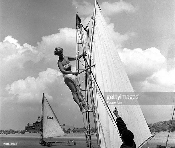England 23rd June 1955 Sand Yachting Mrs Bunty Jolly goes aloft on her Bermuda class sand yacht Michael Halliwell offers a word of advice