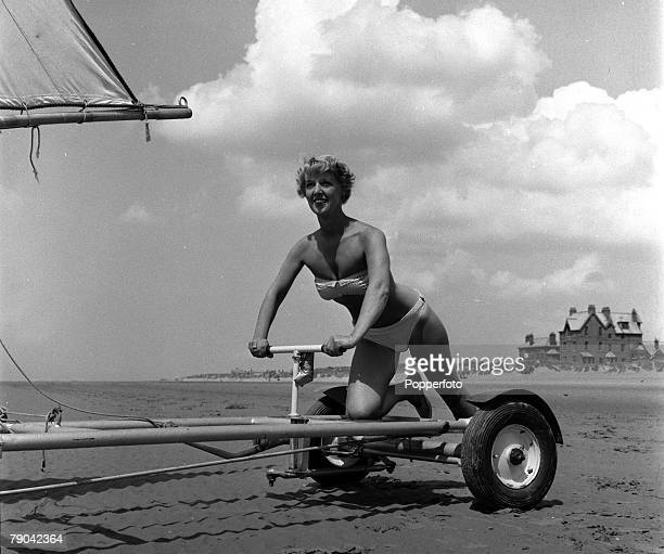 England 23rd June 1955 Sand Yachting Mrs Bunty Jolly the wife of a marine builder is pictured at the tiller of her Bermuda class sand yacht