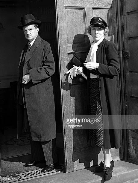 England 3rd October Mr Duff Cooper arriving at the Admiralty to make a resignation speech with Lady Diana Duff Cooper who is wearing a yachting cap