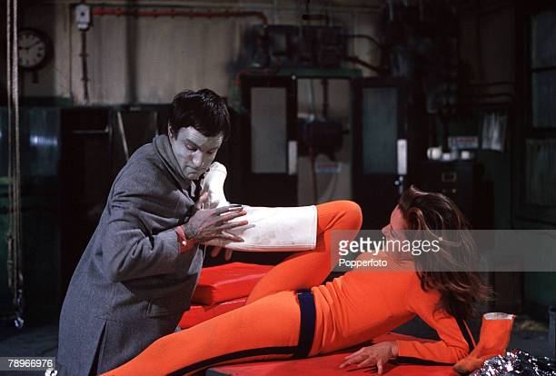 England Actress Diana Rigg fights off a villain in a scene from the television series 'The Avengers'
