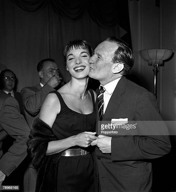 England Actress Elsa Martinelli is pictured being kissed on the cheek by actor Trevor Howard at a press reception at the Mayfair Hotel for the film...