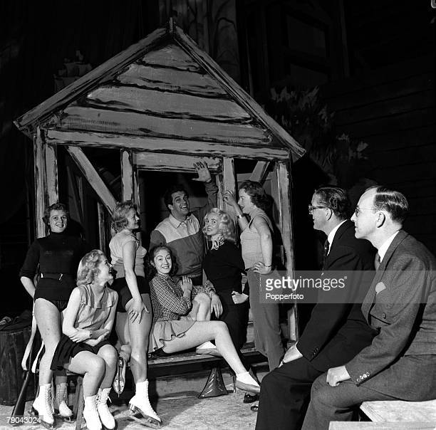 England Agents and talentspotters Billy Marsh and Keith Devon watch one of their stars British singer Frankie Vaughan rehearsing with show girls for...