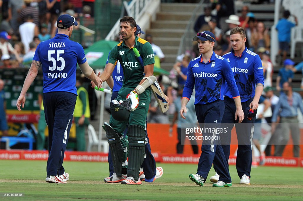 England allrounder, Ben Stokes (L), congratulates South African batsman, David Wiese, after hitting the winning run, to allow South Africa to win the 5th and final One Day International (ODI) match, being played against South Africa, at Newlands on February 14, 2016, in Cape Town. South Africa won the ODI 3-2. / AFP / RODGER BOSCH