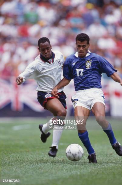 England and Arsenal striker Ian Wright moves in to tackle Brazilian defender Cafu for the ball during the 1993 US Cup soccer tournament game between...