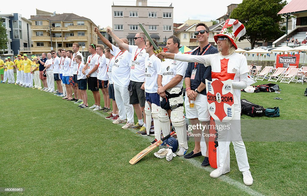 England and Australian fans sing the national anthems ahead their cricket match during the Yorkshire Tea Beach Party at Coogee Beach on January 2, 2014 in Sydney, Australia.