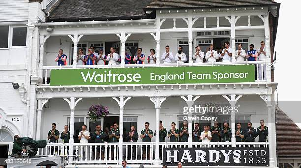 England and Australian players observe a minutes applause in memory of Former South African cricketer Clive Rice ahead of day one of the 4th Investec...