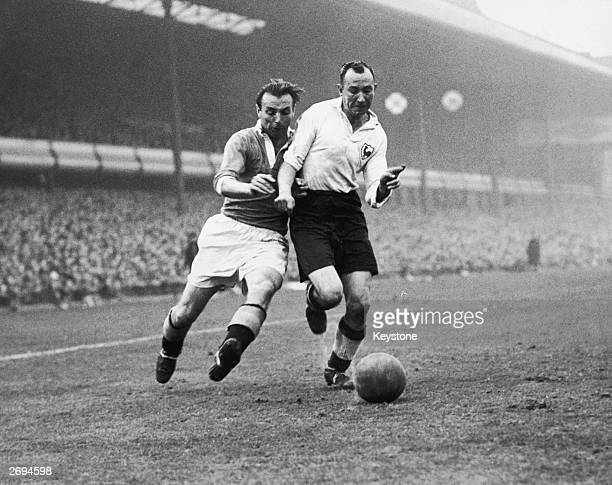 England and Blackpool legend Stanley Matthews tussling with Ron Burgess of Tottenham Hotspur during an FA Cup semifinal at Villa Park