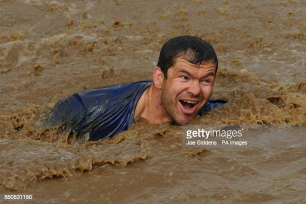 England and British and Irish Lions assistant coach Andy Farrell takes part in Tough Mudder 2013 at Boughton House Kettering