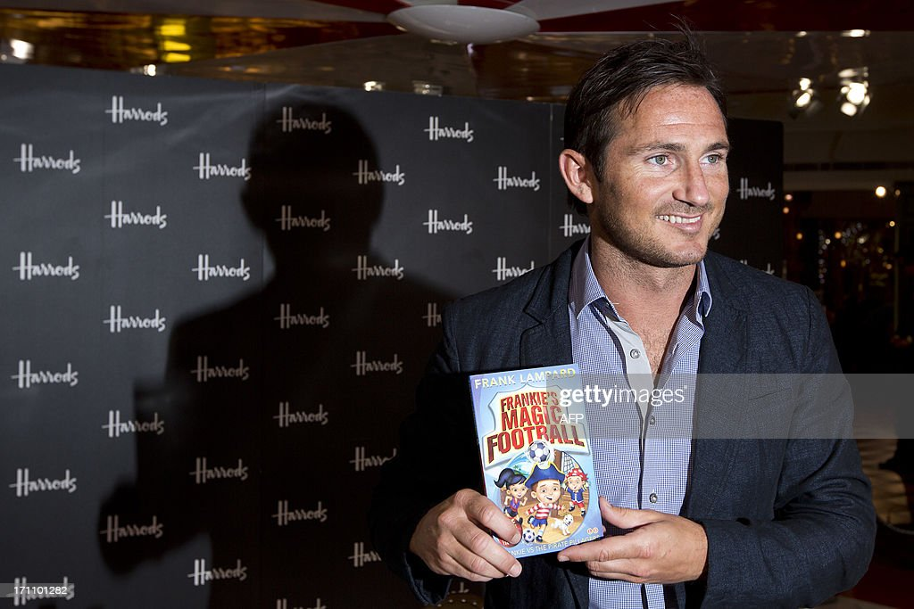 England and Chelsea football player Frank Lampard poses for photographers before signing copies of his new children's book Frankie's Magic Football: Frankie vs the Pirate Pillagers in London on June 22, 2013.