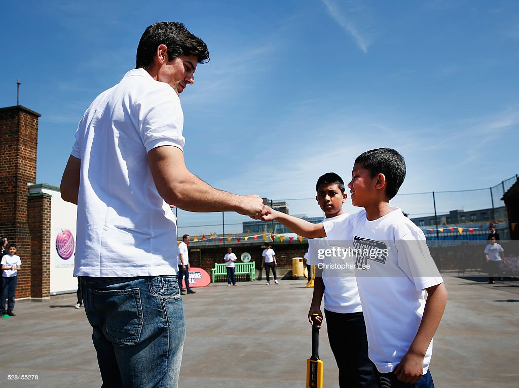 England and Essex Cricketer <a gi-track='captionPersonalityLinkClicked' href=/galleries/search?phrase=Alastair+Cook+-+Cricket+Player&family=editorial&specificpeople=571475 ng-click='$event.stopPropagation()'>Alastair Cook</a> fist pumps a pupil as he joins pupils from the Hague School in a game of cricket during the Launch of the Yorkshire Tea Cricket Commentator Search at The Hague Primary School on May 5, 2016 in London, England.