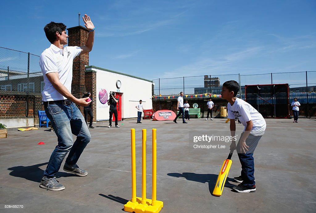 England and Essex Cricketer <a gi-track='captionPersonalityLinkClicked' href=/galleries/search?phrase=Alastair+Cook+-+Cricket+Player&family=editorial&specificpeople=571475 ng-click='$event.stopPropagation()'>Alastair Cook</a> joins pupils from the Hague School in a game of cricket during the Launch of the Yorkshire Tea Cricket Commentator Search at The Hague Primary School on May 5, 2016 in London, England.