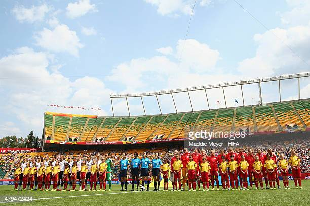 England and Germany stand for their national anthems before the FIFA Women's World Cup 2015 third place playoff match between Germany and England at...