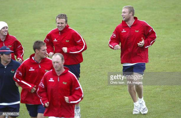 England and Lancashire cricketer Andrew with team mates on the nursery ground at the Rose Bowl in Southampton after the first day of their LV County...