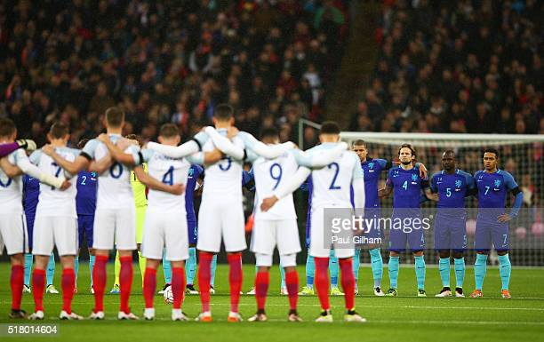 England and Netherlands players observe a minute of silence for the victims of Brussels terror attacks prior to the International Friendly match...