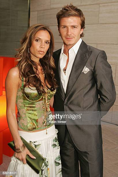 England and Real Madrid football player David Beckham and wife Victoria pose at 'The David Beckham Academy' launch party at Creative Artists Agency...