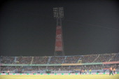 England and South Africa cricketers walk back to the pavillion as play stopped after one of floodlight tower malfuntioned during the ICC World...
