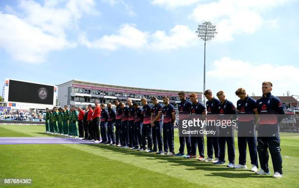 England and South African cricketers line up for a minutes silence ahead of the 1st Royal London ODI match between England and South Africa at...