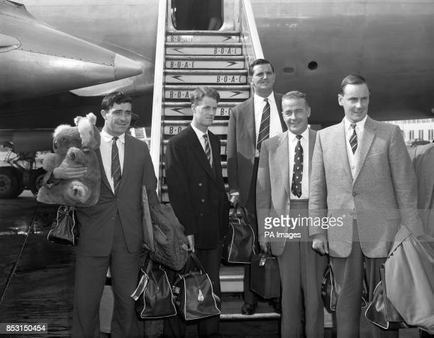 England and Surrey captain Peter May with other members of the MCC touring party on arrival at London Airport from the tour of Australia and New...