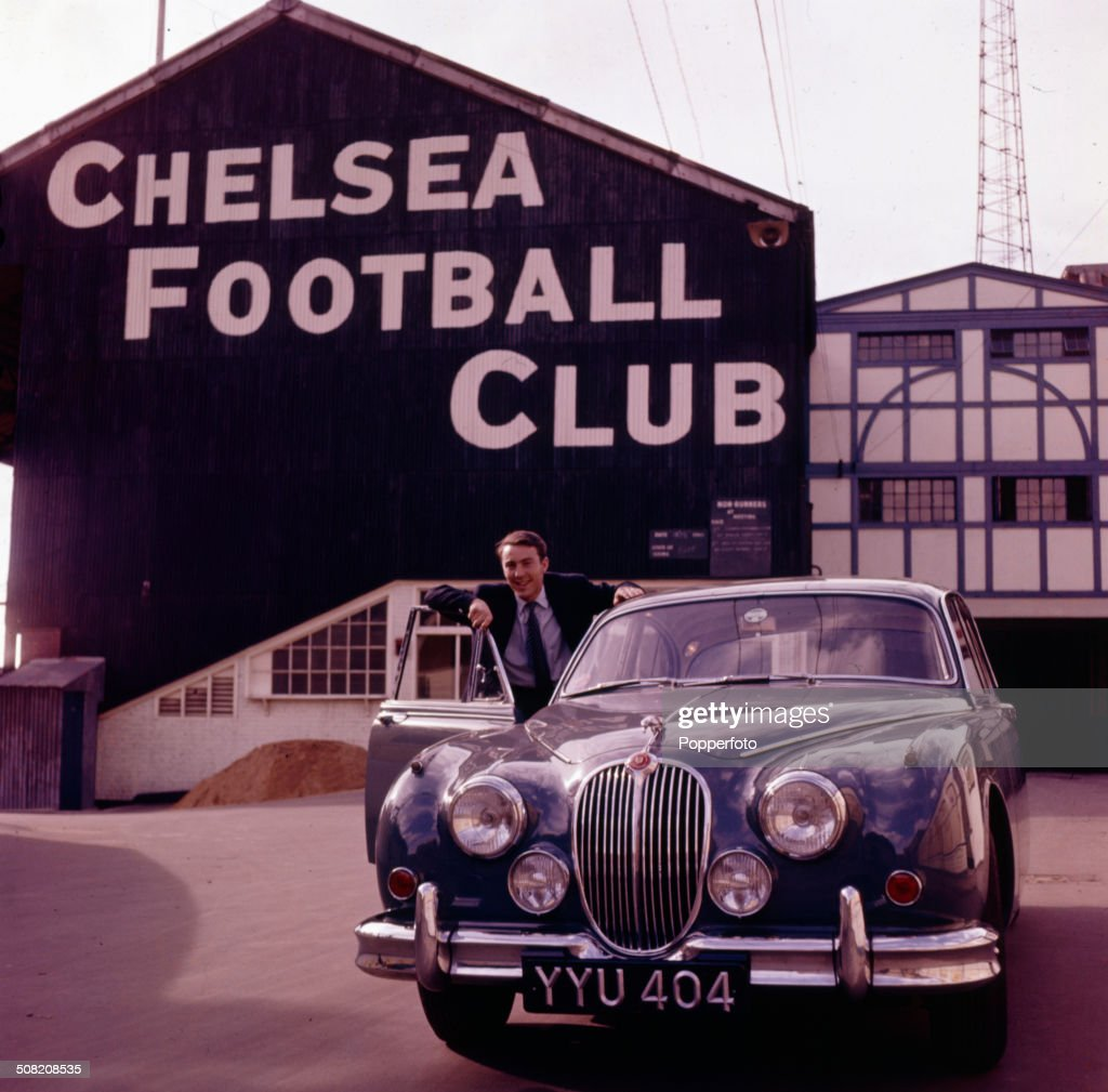 England and Tottenham Hotspur footballer Jimmy Greaves posed at the door of his Jaguar Mark 2 car outside Stamford Bridge Chelsea's football ground...