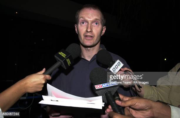 England and Wales Cricket Board press officer Andrew Walpole reads a statement outside the England team hotel in Rawalpindi Pakistan after Alec...