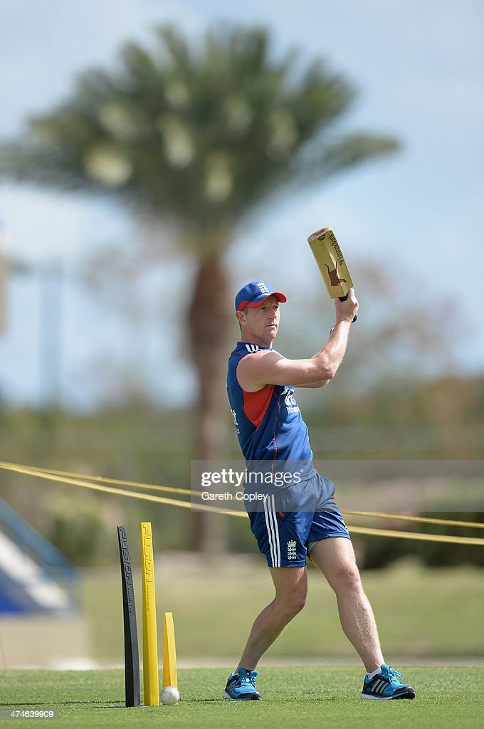England assistant coach Paul Collingwood hits up balls in a fielding drill during a nets session at Sir Viv Richards Cricket Ground on February 24, 2014 in Antigua, Antigua and Barbuda.