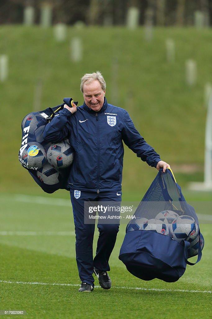 England assistant manager <a gi-track='captionPersonalityLinkClicked' href=/galleries/search?phrase=Ray+Lewington&family=editorial&specificpeople=224730 ng-click='$event.stopPropagation()'>Ray Lewington</a> carries bags of balls during the England training session at St Georges Park on March 22, 2016 in Burton-upon-Trent, England.