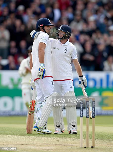 England batsman Alastair Cook is congratulated by Adam Lyth after he becomes the hightest test run scorer for England during day two of the 2nd...