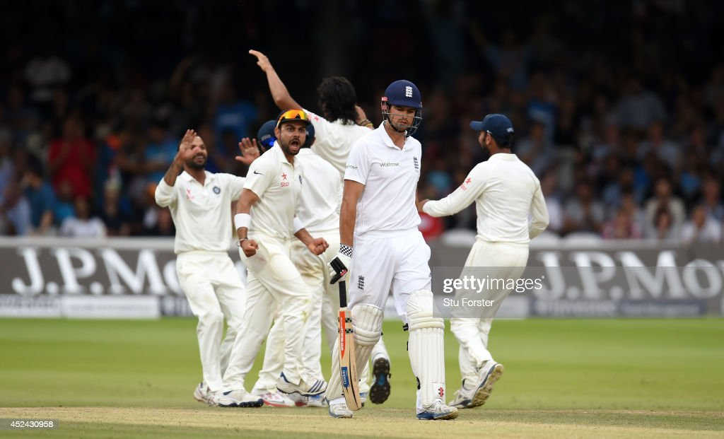 England batsman <a gi-track='captionPersonalityLinkClicked' href=/galleries/search?phrase=Alastair+Cook+-+Cricket+Player&family=editorial&specificpeople=571475 ng-click='$event.stopPropagation()'>Alastair Cook</a> leaves the crease after being dismissed as the India fielders celebrate during day four of 2nd Investec Test match between England and India at Lord's Cricket Ground on July 20, 2014 in London, United Kingdom.